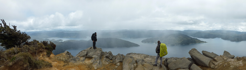 On top of Mt Panekire we admire the view over Lake Waikaremoana, under the rain