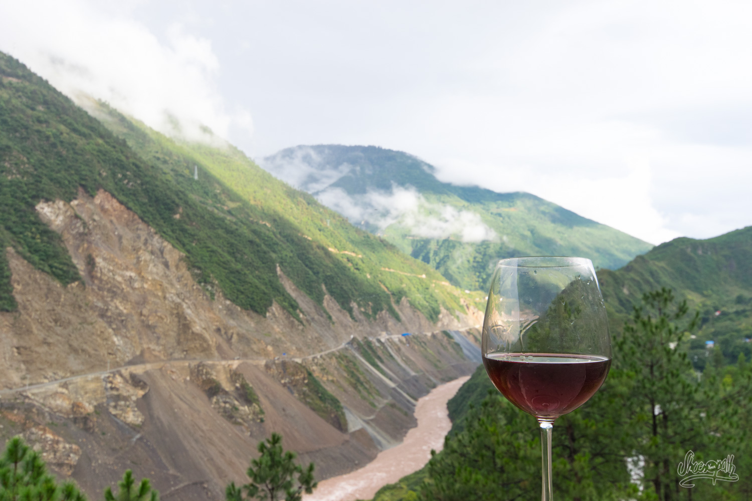 A glass of wine from Yunnan, wine from the Mekong, with a view on the valley