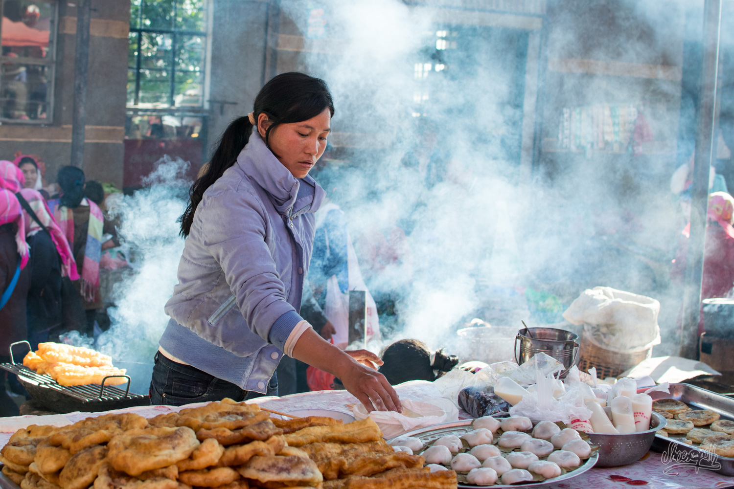 A woman during the market in Xiding