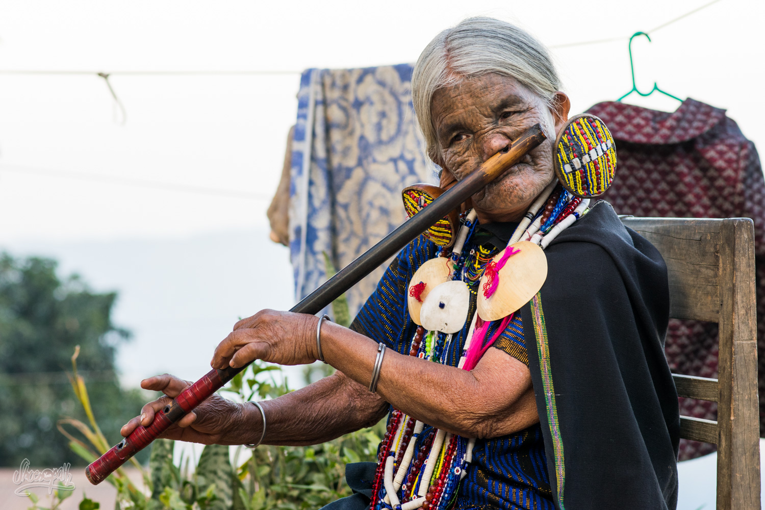 Daw Yaw Hting, 88 years old, one of the last Chin women with a tatoo on her face, playing flute with her nose !
