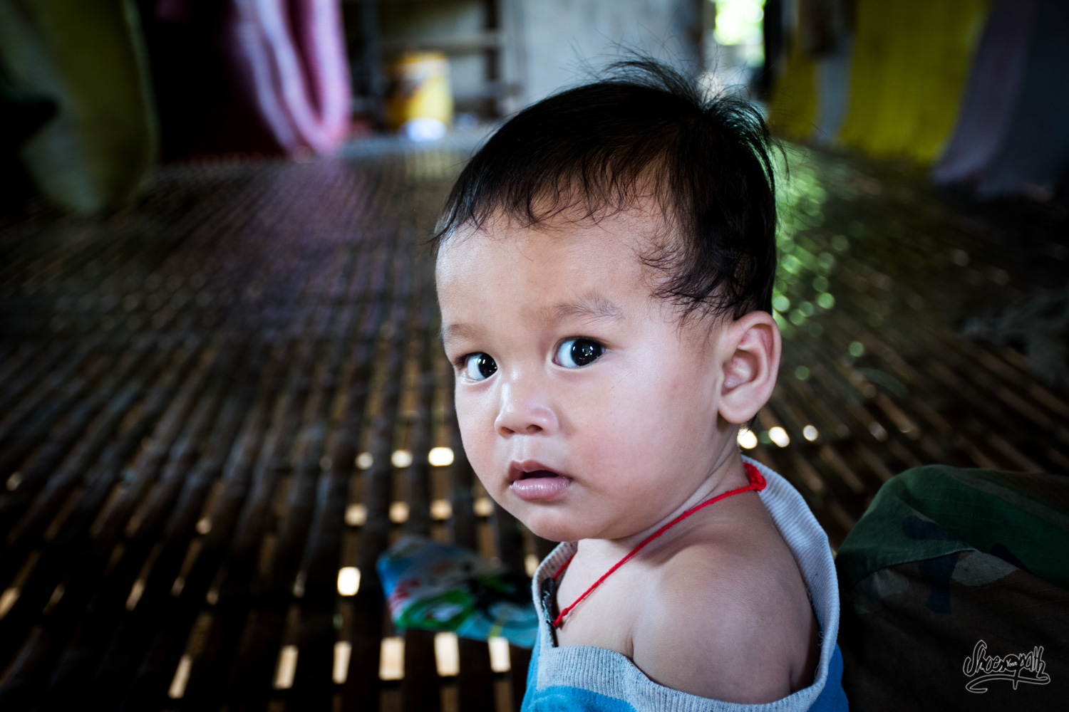 A cute young khmer inside his parent's house