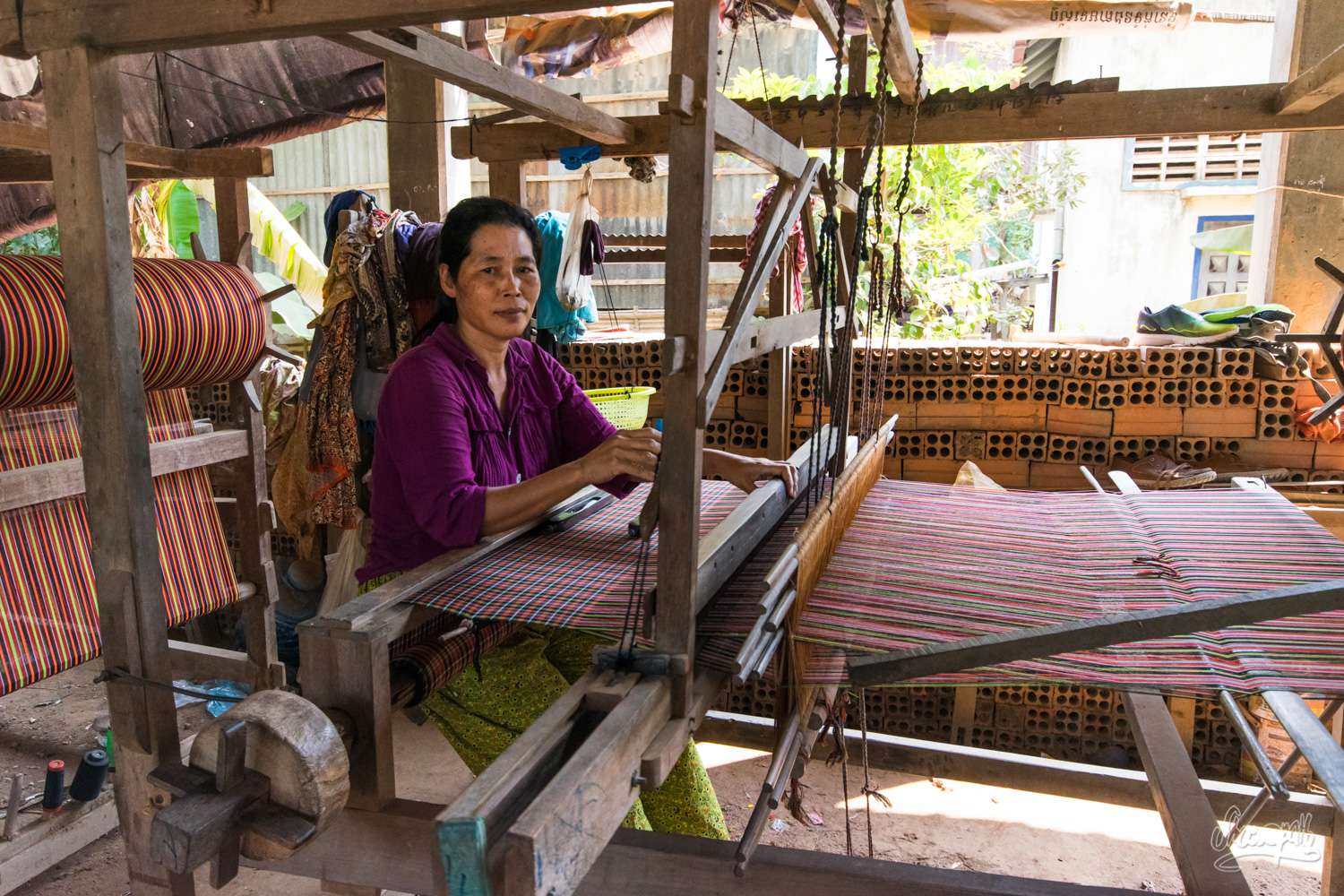 A beautiful woman weaving silk on the silk islands