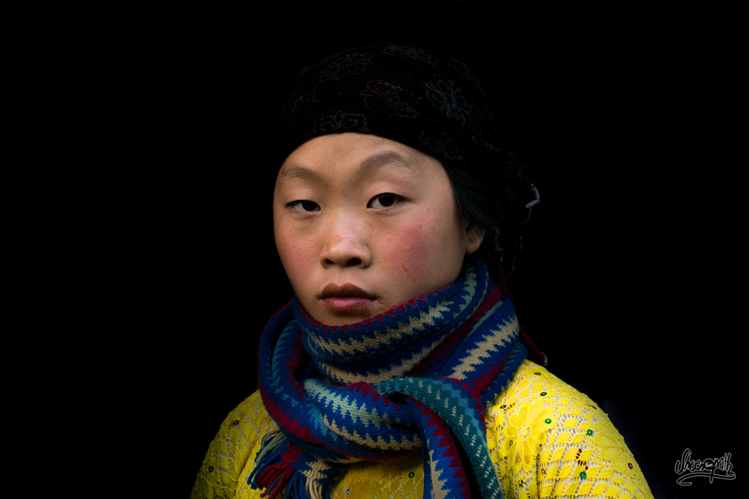 A Hmong woman in the darkness