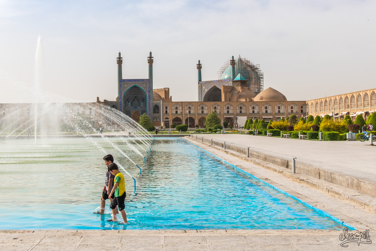 Kids playing in the fountain of Naqsh-e-jahan square